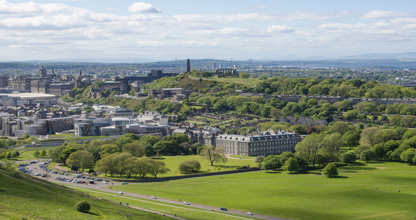 Edinburgh city and Holyrood Park viewed from above St Margaret's Loch